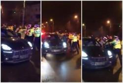 Dacă ai Porsche, eşti smecher, poţi să urci poliţiştii pe capota lui (FOTO/Video)