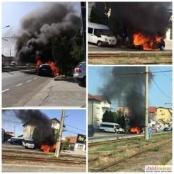 Flăcări înalte de câţiva metri au cuprins o maşină pe Calea Radnei