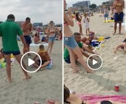 VIDEO- Nesimţire fără margini pe o plajă din Mamaia! Turişti surprinşi în timp ce îşi astupă resturile de hrană în nisip