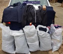 Haine, încălţăminte şi parfumuri contrafăcute, confiscate de poliţiştii arădeni