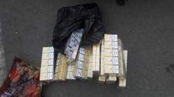 18 cartușe de țigări netimbrate, ridicate în vederea confiscării în această dimineață de Jandarmii Arădeni