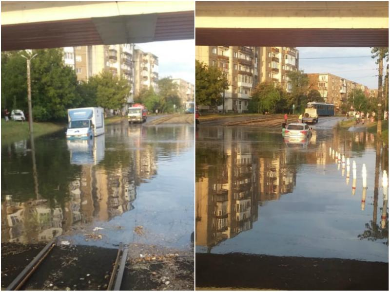 Doi șoferi au rămas blocați în valurile apelor căzute în urma ploii de vară