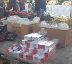 Țigări de contrabandă ascunse în lada cu banane, la piață