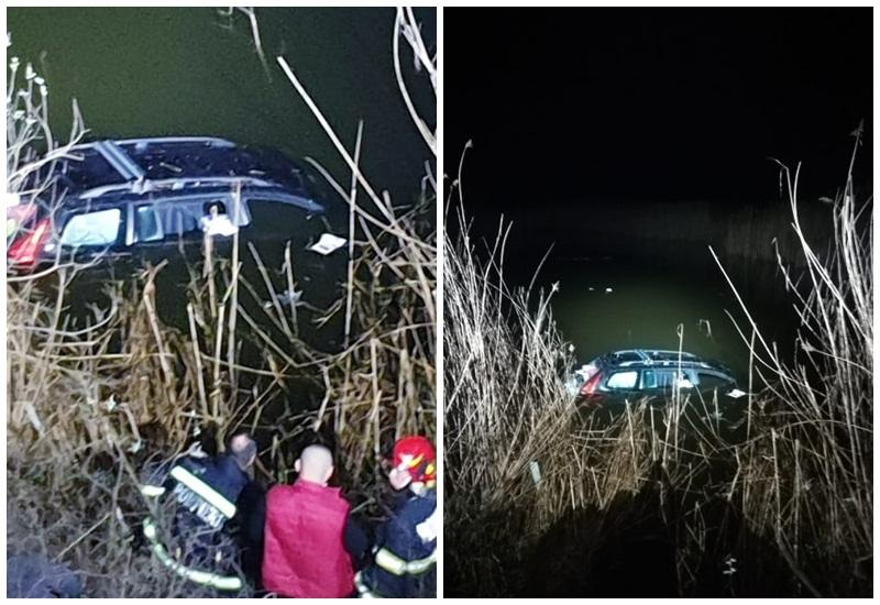 Au căzut cu maşina în Lacul Ghioroc