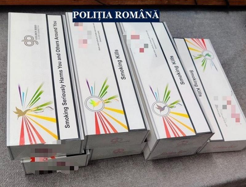 Prinși în timp ce transportau țigări de contrabandă