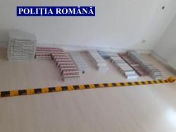 Țigări în valoare de 41.000 de lei confiscate de la contrabandiști la Zăbrani în urma unor percheziții domiciliare